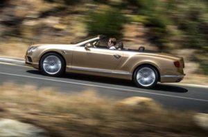 Gold bentley continental GTC convertible driving
