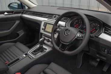 the black leather interior of the Volkswagen Passat Saloon