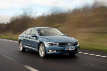 Volkswagen Passat in light blue driving