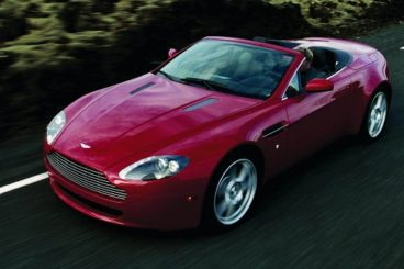Aston Martin V8 Vantage Roadster in red driving