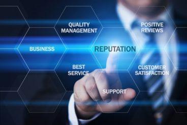 Man flicking through technological screen finding the best leasing broker