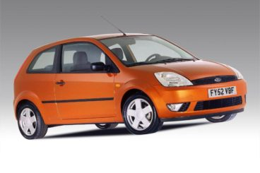Orange Ford Fiesta in white showroom
