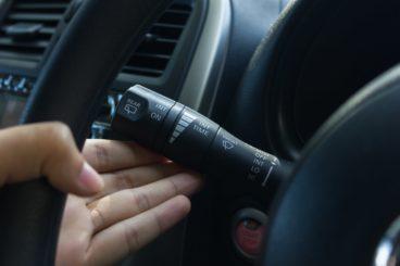 man using left indicator stick in car