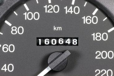 close up of car speedometer 160,648 miles