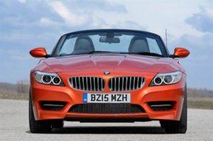 BMW Z4 roadster in metallic orange driving