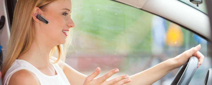 Woman talking on bluetooth in car