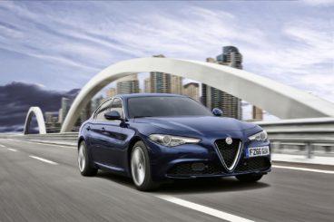 Alfa Romeo Giulia driving over bridge
