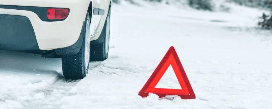 Hazard sign by car
